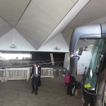 Ship's agents efficiently guide passengers to board the airport transfer buses
