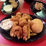 8 huge butterflied fried shrimp w/ fries and slaw, and boudin balls w/ ranch dressing dip.