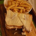 Is this really a club sandwich, with half cooked reheated chips!