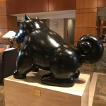 Intriguing bronze dog sculpture by Fernando Botero in the hotel lobby