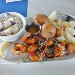 Tiny Shrimp Brochette with steamed Red potatoes and Cole slaw.