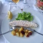 Delicious grilled fish with potatoes and salad