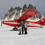 My husband and me (and the plane we came in) on the Pika Glacier.