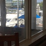 Great view of the waterway, and next to the Yacht Club, with seating, and bars, inside and out.