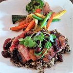 Smoked Duck Breast w/ black-cherry port au jus & ginger-cardamom wild rice.