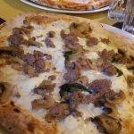 pizza margherita and pizza con salsiccia, funghi e mozzarella