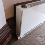 Broken and dirty heater in corridor/entrance