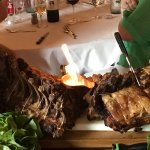 Prime Rib served the large group inside- it was flaming!