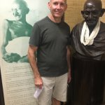 Beside the bust of Ghandi