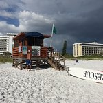 My husband, in front of the life guard stand. (A storm was on the way in the background))