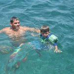 Alfredo swimming with little cousin