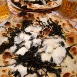 Pizza with mozzarella di buffalo and cicoria