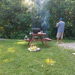 Pic-nic table & fire pit. Photo designates the close proximity of neighboring campsite.