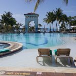 "Main pool area. Fun place to float, have a drink, and ""bump"" into new friends. Beach is just bey"