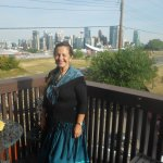 Micheline with the Saddledome and Stampede Park in the background