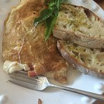 Tasty omelet and bread with olive oil