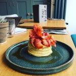 Homemade Buttermilk Pancake Stack with bacon and maple syrup