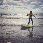 Gracie catching her first wave standing @FREEWAVESURFACADEMY