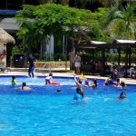 Resort staff gathering guests for Water Zumba