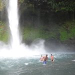 Swimming at the bottom of the falls.