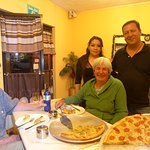 Friends, wonderful proprietors and fabulous pizza!