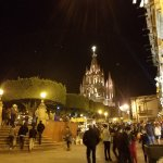 Nighttime celebration in El Jardín with La Parroquia in the background