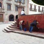 Men chipping paint