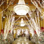 The hotel lobby sparkles in holiday splendor