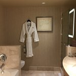 Clean bathroom with a bathing robe