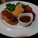 Tea smoked duck breast with Asian style black pepper glaze, adobo potatoes + cassava chips