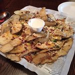 Potato Skins, large portions of potato, not so large portion of toppings.. not good at all.