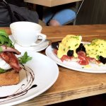 poached eggs and avocado on toast (added bacon) & eggs benedict with parma ham (added black pudd