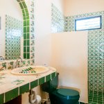 Gorgeous green tiles in upper level room bathroom