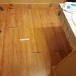 New flooring outside of bathroom. The pieces actually slid back and forth under the trim.