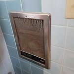 Vent grate next to toilet in bathroom - rusty and filthy dirty