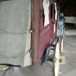 Stage coach located in livestock barn