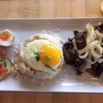 Bistek - seasoned beef with fried onions