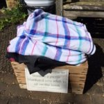 What a lovely idea - blankets you can borrow to have a picnic on the lawn