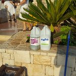 Chemicals used to clean the steps around the pool. A plastic stool left over damage to pool area