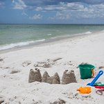 For your beach day, grab sandcastle building tools from our hotel!
