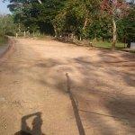 beach road sloping towards beach waters