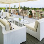 Relax on the outdoor deck at The Dunes and enjoy spectacular views of South Beach.