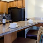 Full kitchens welcome you to Naples in all of our Suites