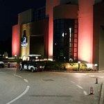 Hotel lit up at night.