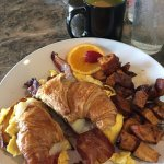 Bacon Egg and cheese croissant. Fired potatoes.