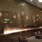"""Lobby with fireplace and """"golden"""" wall"""