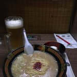 Delicious ramen with an egg on the side.