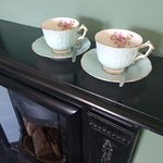 Fireplace and tea cups