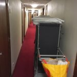 Fire exit blocked by trolley, making wheeled suitcase moving difficult
