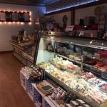 A view of the meat and cheese deli. There are also goat cheese ice creams (or gelato?) that are